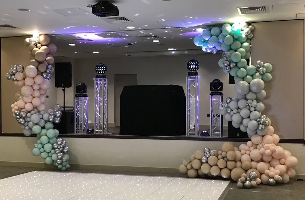 Harbour Hotel Guildford organic wedding balloon stage installation In Surrey