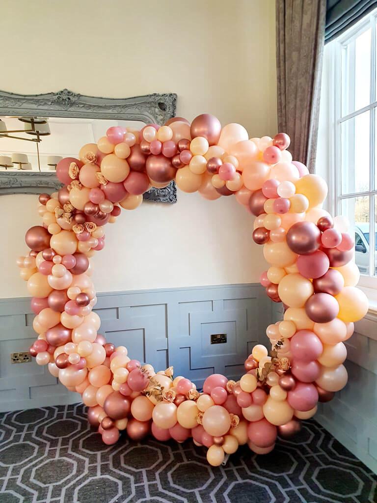 Wokefield Park Hotel Stunning organic balloon hoop with flowers 1 Airmagiation
