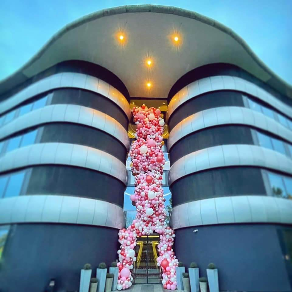 aviator hotel with balloon garland tower display